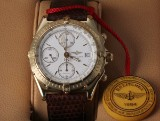 Breitling 'Chronomat'. Men's watch, 18 kt. gold, with white dial, 1990s