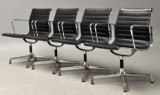 Charles Eames. A set of four armchairs, model EA-108 i sort læder. New generation with chrome rings (4)