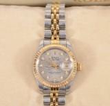 Rolex Oyster Perpetual Datejust. Damarmbandsur i 18k guld på stål