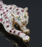 Panther ruby and diamond brooch in 18 kt. gold and white gold, diamonds, total approx. 3.98 ct. F-G/VVS-VS