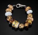 Troldekugler armbånd med tre guldcharms