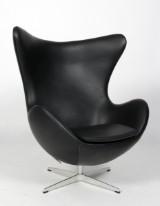 Arne Jacobsen. Lounge chair, The Egg, black Classic leather upholstery, model 3316, 2015