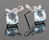 Topaz and diamond earrings, 14kt. white gold (2).