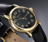 Montblanc 'Star'. A mid-size ladies watch, 18 kt. gold with black dial, 2000s