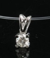 Pendant 18kt set with a brilliant cut diamond 0.25ct