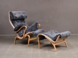 Bruno Mathsson, Dux. Pernilla easy chair and stool, sheepskin (2)