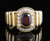 18kt diamond and garnet ring approx. 0.50ct