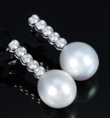 A pair of South Sea pearl and diamond earrings, total approx. 1.20 ct. (2)