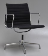 Charles Eames. Armchair, model EA-108, newest generation with chrome ring