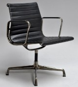 Charles Eames. Armchair, model EA-108, Full Leather, special edition in 'Dark Chrome'