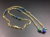 Pomellato, kæde af guld med kugler af malakit-og lapislazuli