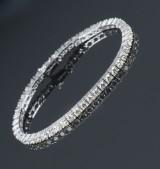 Ti Amo.Tennis bracelet, 14 kt. white gold, total approx. 7.05 ct