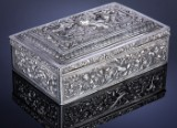 Chinese box in silver, richly embellished with dragons, birds, etc., c. 1880-1900