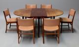 N.O. Møller & Kai Lyngfeldt Larsen. Spisebord i palisander med skjult tillægsplade samt seks palisander stole (7)