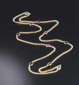 Poul Klarlund, København. Long 14 kt. gold necklace with gemstones