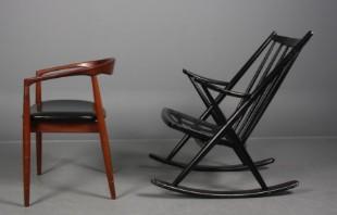 N. Eilersen. Armstol af teak, sæde betrukket med sort læder