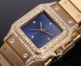 Cartier 'Santos'. Unisex watch, 18 kt. gold, with diamonds