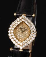 DeLaneau 'Les Delicates'. Ladies watch, 18 kt. gold with numerous diamonds
