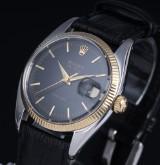Rolex 'Air-King Precision'. Vintage herreur i 18 kt. guld og stål med sort skive, ca. 1966