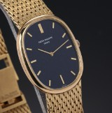 Patek Philippe 'Ellipse'. Vintage men's watch, 18 kt. gold with blue dial