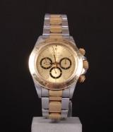 Rolex Daytona Cosmograph. Herrearmbåndsur af 18 kt. guld og stål