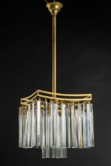 A ceiling lamp / crystal chandelier, brass and glass