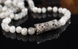 Ole Lynggaard. Clasp, model 'Lace', with faceted grey quartz necklace, 18 kt. white gold