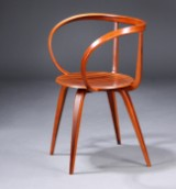 George Nelson, Pretzel Chair, Anniversary Edition 2008. Numbered anniversary model, limited edition in rosewood veneer.