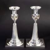 A pair of silver candle sticks following Augsburg model