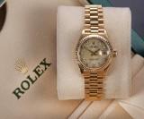 Rolex 'Datejust'. Ladies watch, 18 kt. gold with diamond dial, c. 1991