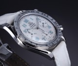 Omega 'Speedmaster'. A large ladies watch, steel with mother of pearl dial, c. 1998