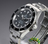 Rolex Submariner. Men's watch, steel, with black dial with date, c. 1989
