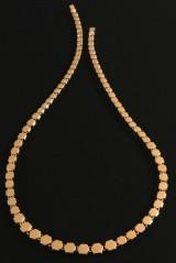 Halskæde af 14 karat guld.