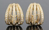 18kt. diamond earrings with pin and pusher approx. 1.00ct