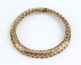Armlænke af 14 kt guld, leddelt. 14,4 gram