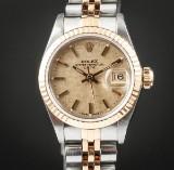 Rolex Date damearmbåndsur af guld 18 kt. og stål, ref. 69173