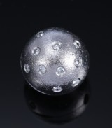 Ole Lynggaard. Ball clasp, 18 kt. satin-finish white gold with diamonds