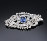 A French sapphire and diamond brooch, platinum. Sapphire approx. 2.44 ct. Diamonds total approx. 5.50 ct
