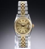 Rolex 'Datejust'. Midsize dameur i 18 kt. guld og stål med champagnefarvet skive, ca. 1978