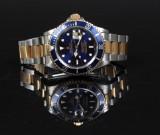 Rolex. Herrearmbåndsur, model Submariner i guld/stål