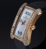Carl F. Bucherer 'Alacria'. Ladies watch, 18 kt. gold, with mother of pearl dial and diamonds, c. 2000