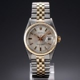 Rolex 'Datejust'. Men's watch, 18 kt. gold and steel, with silver-coloured dial, c. 1972