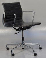 Charles Eames. Leather office chair, model EA-117. New generation with chrome ring