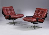 Unknown furniture producer, 1960's. Lounge chairs, black-varnished wood and cognac-coloured leather (2)