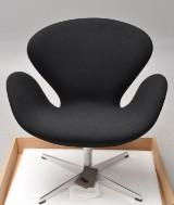 Arne Jacobsen. The Swan with black Tonus wool, model 3320
