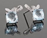 Topaz and diamond earrings, 14kt. white gold (2).