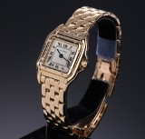 Cartier 'Panthere'. Ladies watch, 18 kt. gold, with pale dial