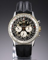 Breitling 'Navitimer Cosmonaut'. Herrechronograf i guld og stål med sort skive, 1990'erne