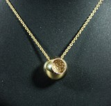 Georg Jensen. 'Cave' pendant, 18K gold, with pavé-set diamonds and chain (2)