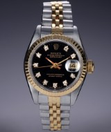 Rolex 'Datejust'. Ladies watch, 18 kt. gold and steel, with black diamond dial, c. 1987